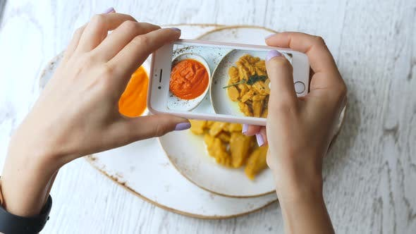 Food Photography. Hands Taking Picture Of Food