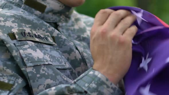 Sad US Army Soldier Crying Holding Flag, Memorial Ceremony