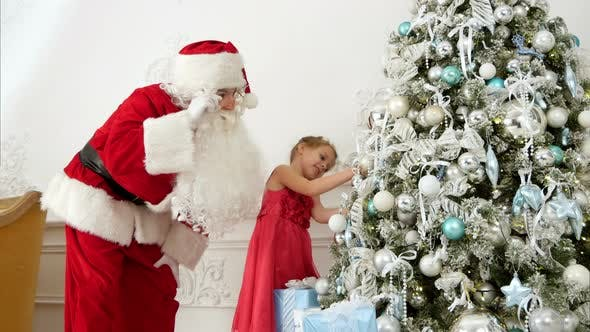 908680006f7c2 Santa Claus Helping Pretty Little Girl To Decorate Christmas Tree (Stock  Footage)