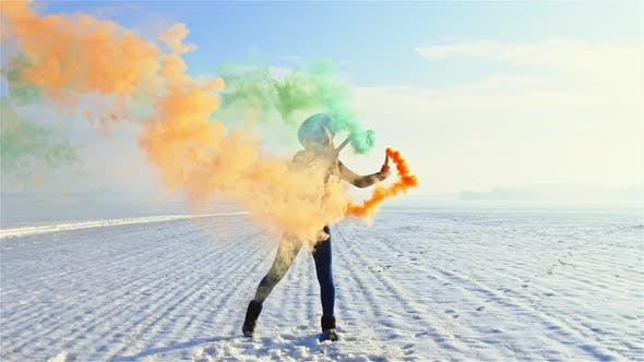 Woman with Colorful Smoke Bombs by procinemastock | VideoHive