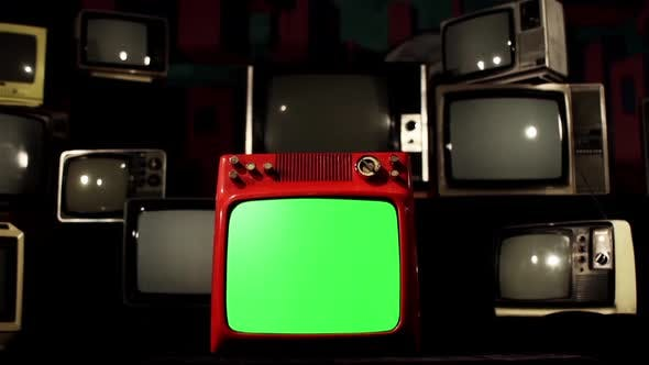 Old TV Green Screen and Stack of Old TV appearing in Background.