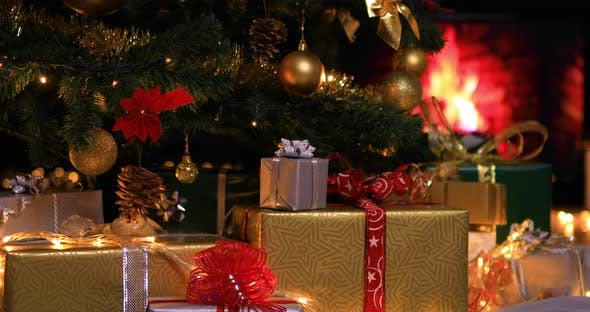 Christmas Gifts Near Christmas Tree And Fireplace By Marianst