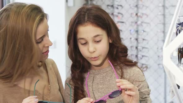 e1d1c436c1cb Beautiful Young Woman Trying on Sunglasses with Her Cute Little Sister (Stock  Footage)