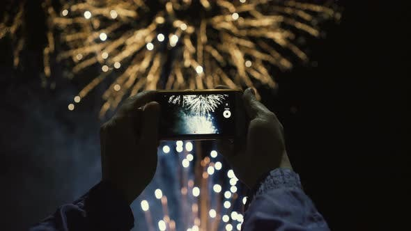 Silhouette of a Man Photographing Fireworks at Night Sky  Beautiful