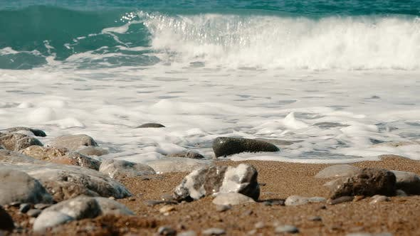 Sea Waves Are Crashing on Stones and Spraying in Slow Motion