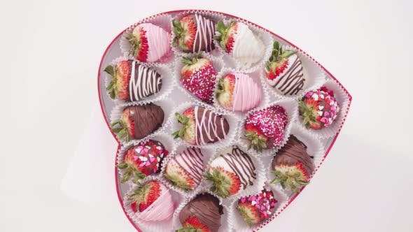 Flat Lay Step By Step Variety Of Chocolate Dipped Strawberries In A Heart Shaped Gift Box By Arinahabich