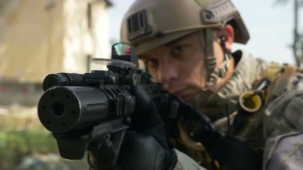 Soldier With Gun And Headset Aiming Target In Tactical