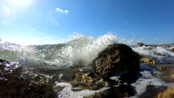 Sea Waves Crushing on a Rocky Beach by sergiostock | VideoHive