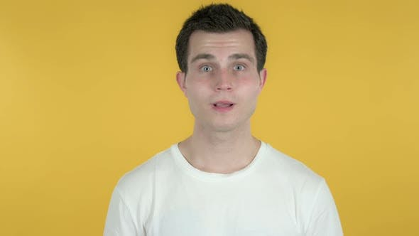 Yes, Man Shaking Head To Accept, Yellow Background by