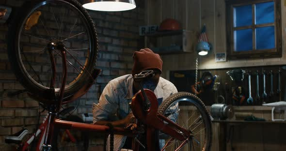 Man Working in a Bicycle Repair Shop by FrameStock | VideoHive