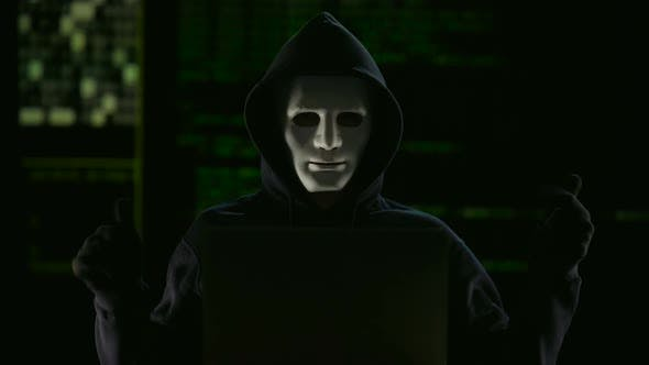 Hacker In Mask And Gloves Breaking Government Servers By
