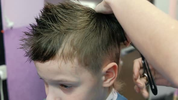 Barber S Hands Combs And Cutting Blond Short Boy S Hair With