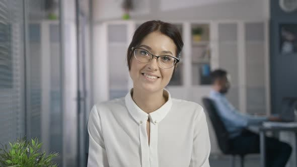 fe4aa80d9a77bf Cute Sexy Woman with Beautiful Style in Glasses in Office Place Look and  Smile (Stock Footage)