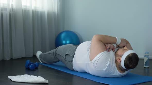 Obese Male Exercising Abdominal Endurance Training Sit Ups