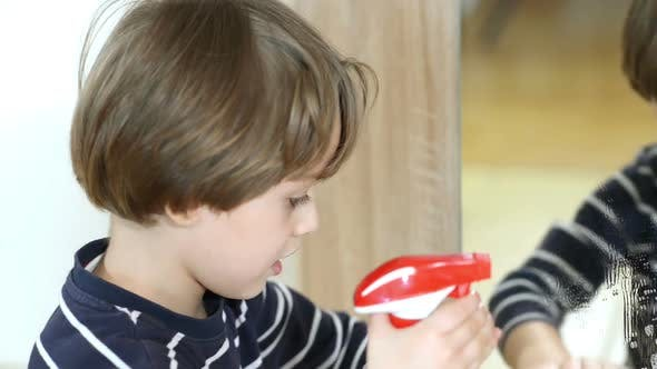 Boy Cleaning the Mirror by oneblink1 | VideoHive
