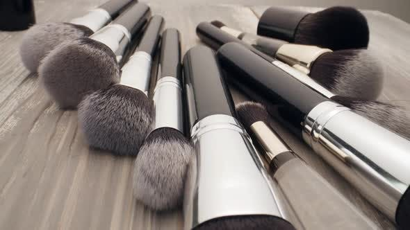 Cosmetics And Beauty Concept Make Up Brushes On Wooden Table By