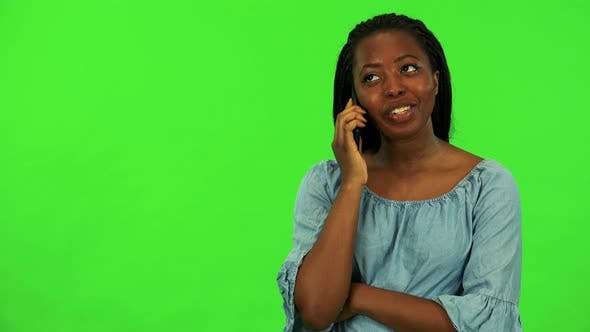 A Young Black Woman Call with Smartphone - Green Screen