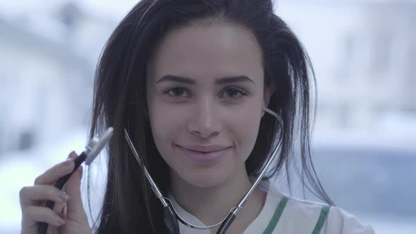 Portrait Of Beautiful Smiling Girl Close Up Young Brunette
