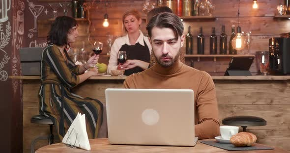 Young Business Man Finishing His Work Closing His Laptop