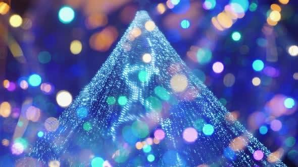 A Christmas.Street Festive Lighting Blurry Lights Of A Christmas Tree