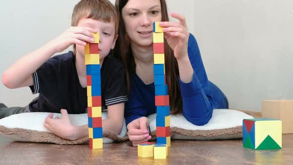 Building a Towers From Blocks. Mom and Son Playing Together with ...