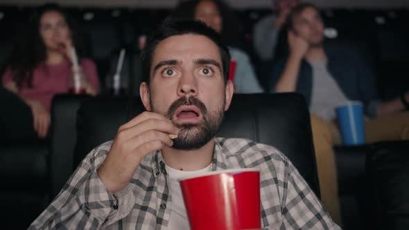 Slow Motion of Scared Guy Eating Popcorn Watching Shocking Movie ...