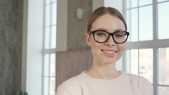 da28ca359060 Pretty Girl Looking at Camera and Smiling. Beautiful Woman in Stylish  Glasses (Stock Footage)
