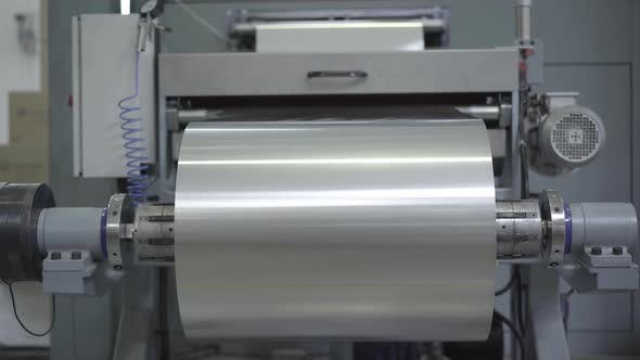 Big Roll of Aluminium Foil Sheet Rolling on Industrial Machinery. Equipment  Working in Factory by photo_oles