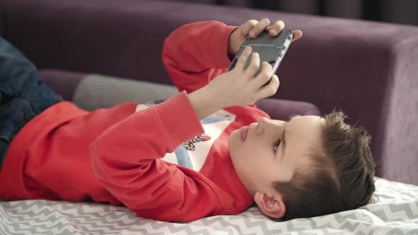 Image result for kid play game on mobile phone