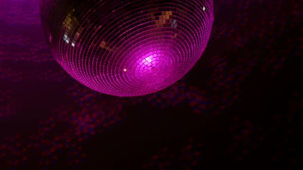 Spinning Mirrored Sphere Disco Ball With Reflections By Colorful Lights Stock Footage