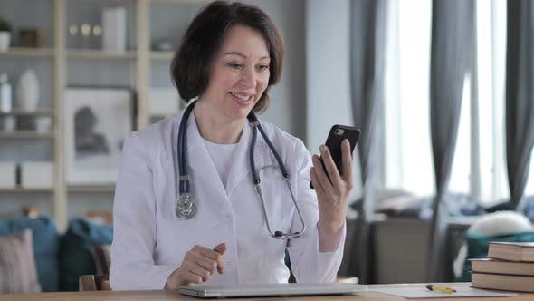 Online Video Chat By Old Lady Doctor Via Smartphone by WhiteMilk